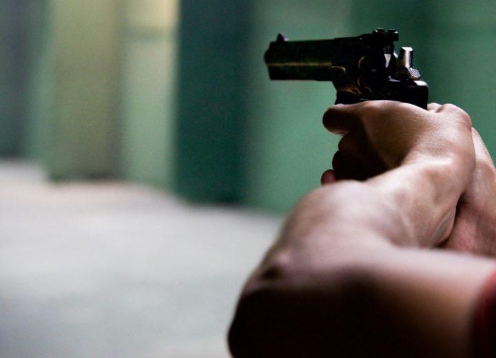 A person aiming a gun